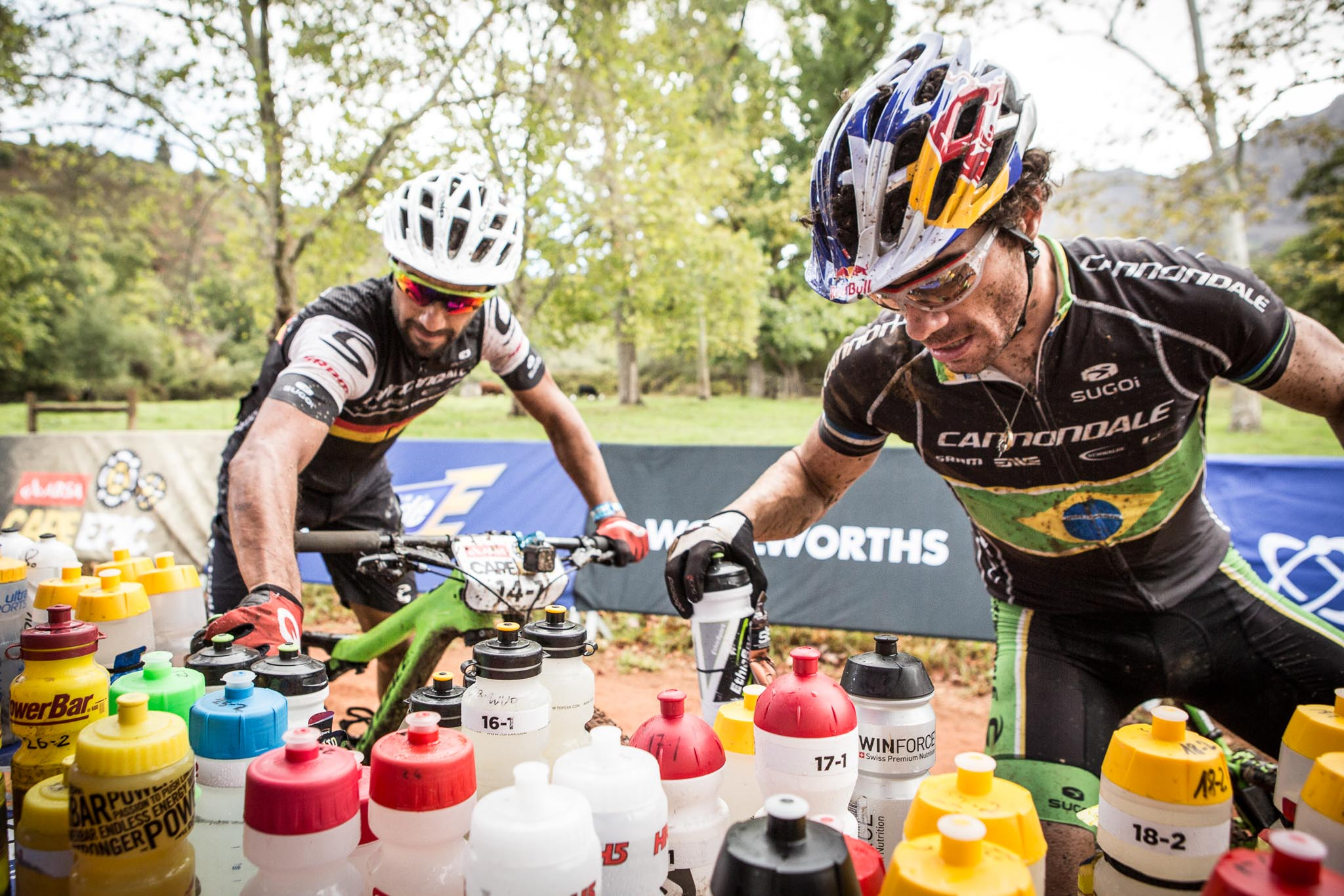Manuel Fumic and Henrique Avancini of Team Cannondale Factory Racing take on some liquid during stage 6 of the 2016 Absa Cape Epic Mountain Bike stage race from Boschendal in Stellenbosch, South Africa on the 19th March 2015 Photo by Nick Muzik/Cape Epic/SPORTZPICS PLEASE ENSURE THE APPROPRIATE CREDIT IS GIVEN TO THE PHOTOGRAPHER AND SPORTZPICS ALONG WITH THE ABSA CAPE EPIC ace2016