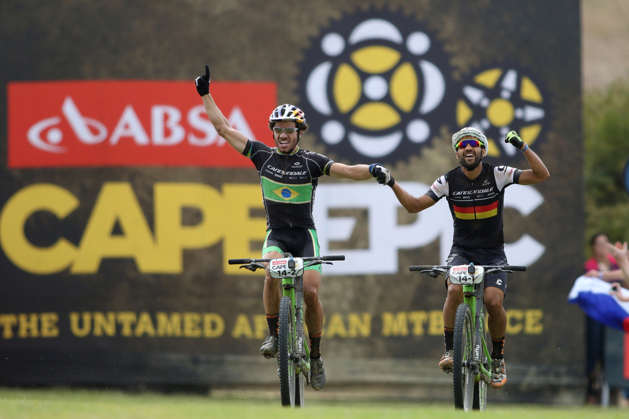 Henrique Avancini and Manuel Fumic of Cannondale Factory Racing celebrate winning the final stage during the final stage (stage 7) of the 2016 Absa Cape Epic Mountain Bike stage race from Boschendal in Stellenbosch to Meerendal Wine Estate in Durbanville, South Africa on the 20th March 2016 Photo by Shaun Roy/Cape Epic/SPORTZPICS PLEASE ENSURE THE APPROPRIATE CREDIT IS GIVEN TO THE PHOTOGRAPHER AND SPORTZPICS ALONG WITH THE ABSA CAPE EPIC {ace2016}