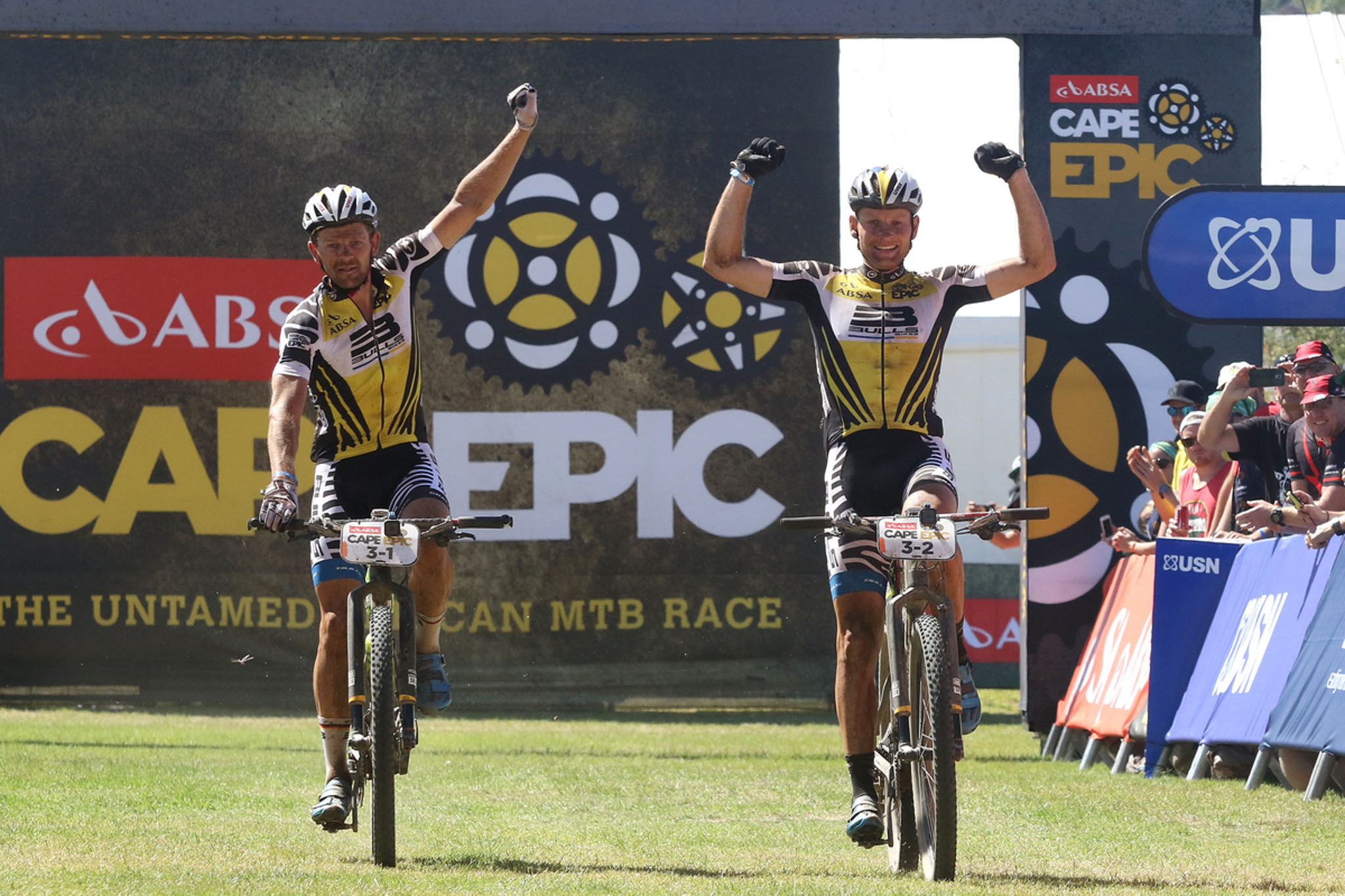 Karl Platt and Urs Huber of the Bulls celebrate winning stage 3 during stage 3 of the 2016 Absa Cape Epic Mountain Bike stage race held from Saronsberg Wine Estate in Tulbagh to the Cape Peninsula University of Technology in Wellington, South Africa on the 16th March 2016 Photo by Shaun Roy/Cape Epic/SPORTZPICS PLEASE ENSURE THE APPROPRIATE CREDIT IS GIVEN TO THE PHOTOGRAPHER AND SPORTZPICS ALONG WITH THE ABSA CAPE EPIC {ace2016}