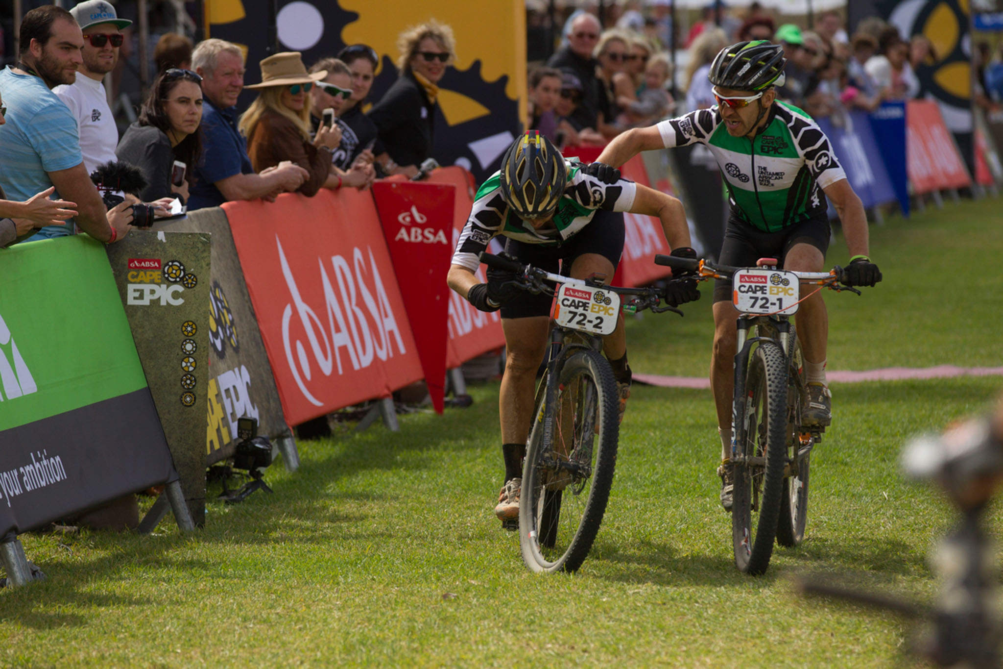 An exhausted Fanny Bourdon finishes with partner Jean-Francois Bossler after winning the Green Mixed Jersey during the final stage (stage 7) of the 2016 Absa Cape Epic Mountain Bike stage race from Boschendal in Stellenbosch to Meerendal Wine Estate in Durbanville, South Africa on the 20th March 2016 Photo by Gary Perkin/Cape Epic/SPORTZPICS PLEASE ENSURE THE APPROPRIATE CREDIT IS GIVEN TO THE PHOTOGRAPHER AND SPORTZPICS ALONG WITH THE ABSA CAPE EPIC ace2016