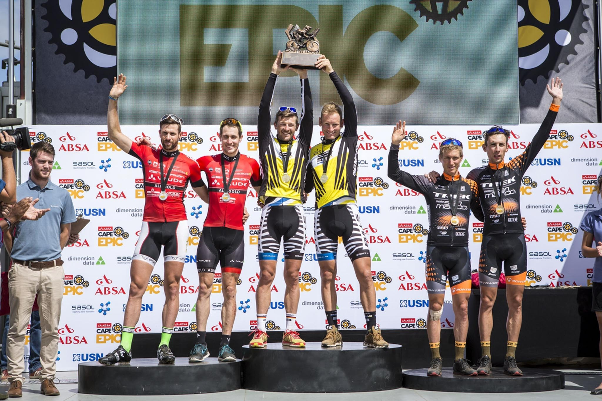 The overall mens podium of (L) Nicola Rohrbach and Matthias Pfommer of Team Centurion Vaude by Meerendal 2, (c) Karl Platt and Urs Huber of Team Bulls 1 and (R) Samuele Porro and Damiano Ferraro of Team Trek-Selle San Marco A during the final stage (stage 7) of the 2016 Absa Cape Epic Mountain Bike stage race from Boschendal in Stellenbosch to Meerendal Wine Estate in Durbanville, South Africa on the 20th March 2016 Photo by Nick Muzik/Cape Epic/SPORTZPICS PLEASE ENSURE THE APPROPRIATE CREDIT IS GIVEN TO THE PHOTOGRAPHER AND SPORTZPICS ALONG WITH THE ABSA CAPE EPIC ace2016