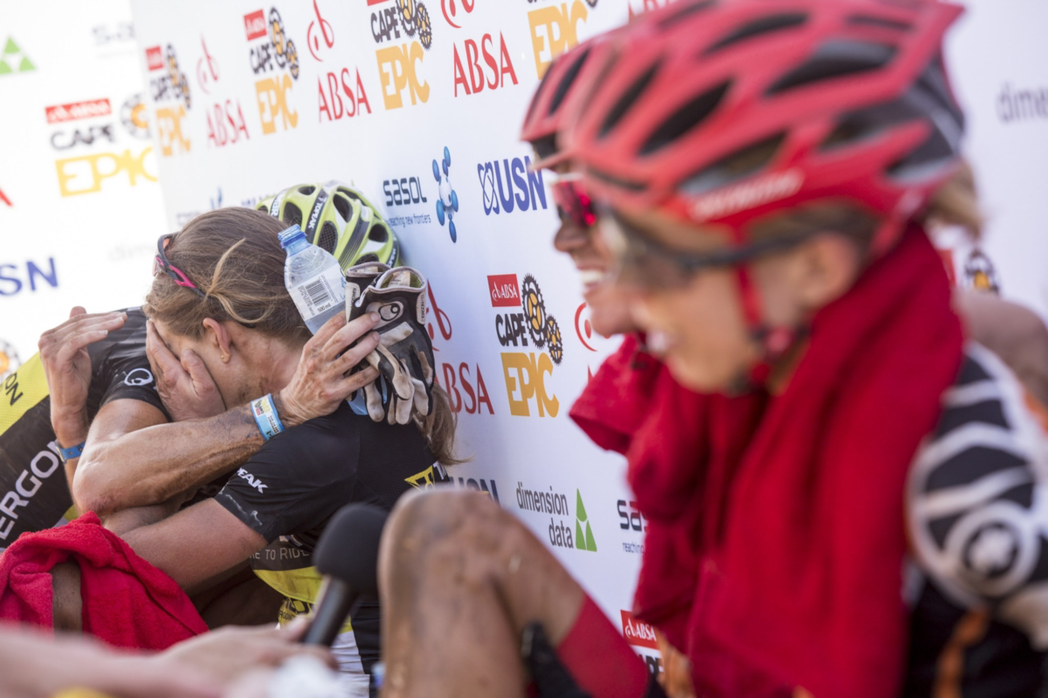 Sally Bigham consoles Adel Morath after stage 3 of the 2016 Absa Cape Epic Mountain Bike stage race held from Saronsberg Wine Estate in Tulbagh to the Cape Peninsula University of Technology in Wellington, South Africa on the 16th March 2016 Photo by Sam Clark/Cape Epic/SPORTZPICS PLEASE ENSURE THE APPROPRIATE CREDIT IS GIVEN TO THE PHOTOGRAPHER AND SPORTZPICS ALONG WITH THE ABSA CAPE EPIC ace2016