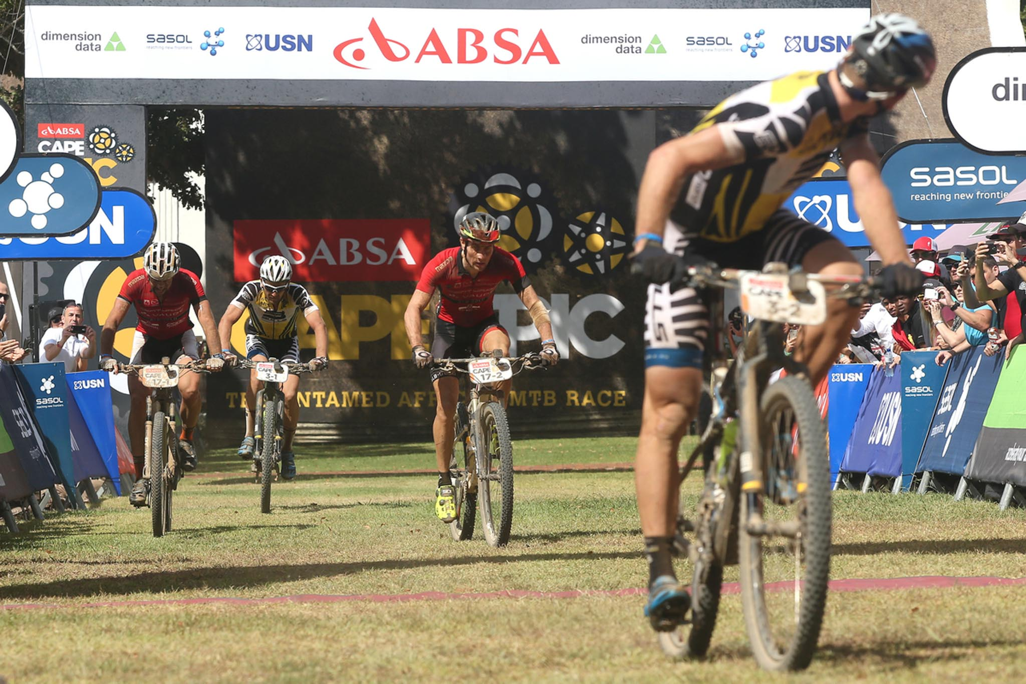 Urs Huber of the Bulls looks back to his partner as Nicola Rohrbach and Matthias Pfommer of Centurion Vaude by Meerendal 2 finish ahead of Karl Platt of the Bulls to win the stage during stage 5 of the 2016 Absa Cape Epic Mountain Bike stage race held from the Cape Peninsula University of Technology in Wellington to Boschendal in Stellenbosch, South Africa on the 18th March 2016 Photo by Shaun Roy/Cape Epic/SPORTZPICS PLEASE ENSURE THE APPROPRIATE CREDIT IS GIVEN TO THE PHOTOGRAPHER AND SPORTZPICS ALONG WITH THE ABSA CAPE EPIC {ace2016}