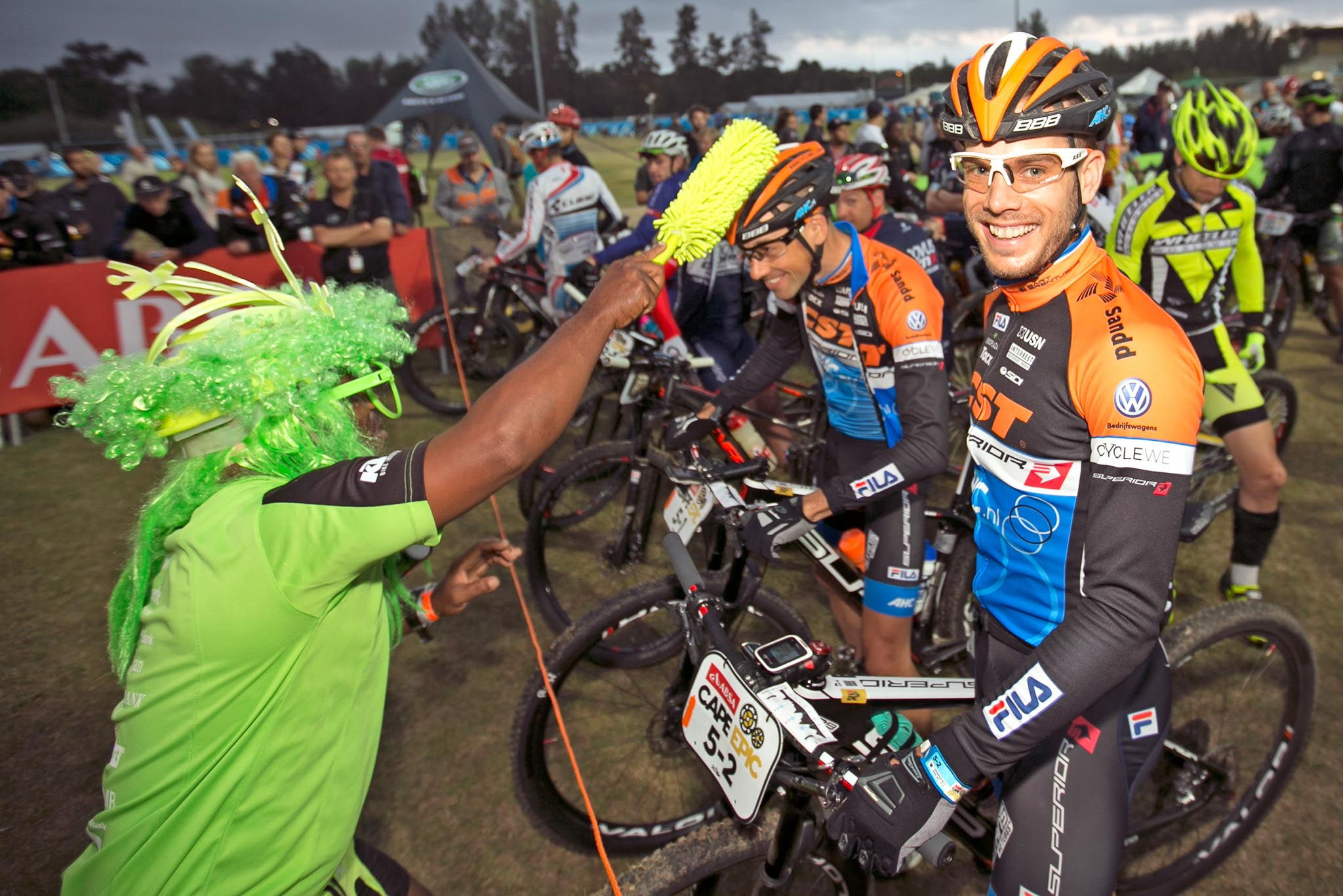 Rudi van Houts enjoying the attention of Sipho from Exxaro during stage 5 of the 2016 Absa Cape Epic Mountain Bike stage race held from the Cape Peninsula University of Technology in Wellington to Boschendal in Stellenbosch, South Africa on the 18th March 2016 Photo by Mark Sampson/Cape Epic/SPORTZPICS PLEASE ENSURE THE APPROPRIATE CREDIT IS GIVEN TO THE PHOTOGRAPHER AND SPORTZPICS ALONG WITH THE ABSA CAPE EPIC ace2016