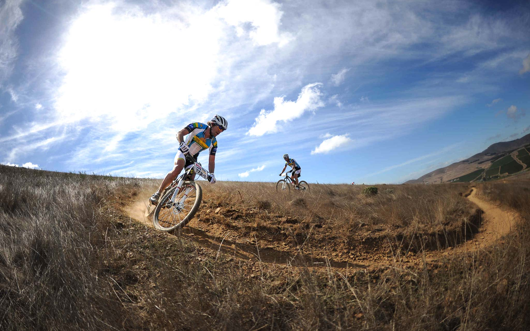 Thomas Frischknecht and Urs Grieg of Team Rwanda Cycling 2 enjoying the singletrack riding during the Prologue of the 2013 Absa Cape Epic Mountain Bike stage race held at Meerendal Wine Estate in Durbanville outside Cape Town, South Africa..Photo by Kelvin Trautman/Cape Epic/SPORTZPICS